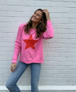 pink sweater with red star