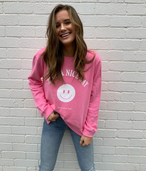 pink smiley face sweater