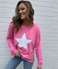 pink sweater with white star