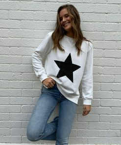 white sweater black star