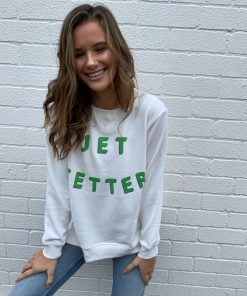 white sweater jetsetter