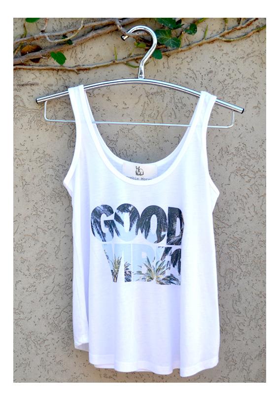 white singlet with good vibes logo